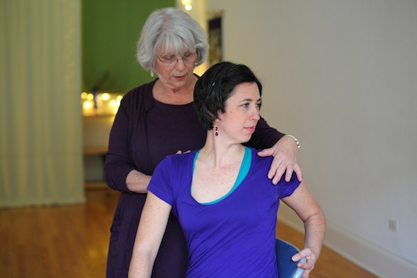 rhoda assisting seated twist